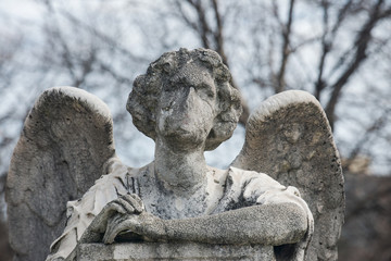 Beautiful Vintage Sculpture at old Catholic cemetery.