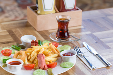 Appetiser plate with garnish and  sauces