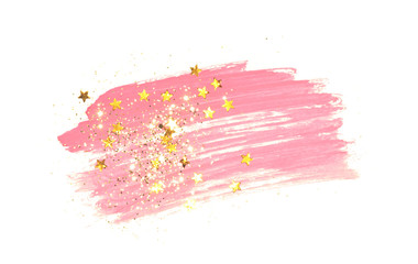 Golden glitter and glittering stars on abstract pink watercolor splash on white background