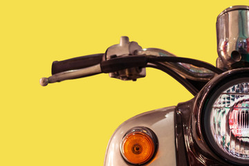 Vintage scooter on yellow background . Post process in vintage style. Close-up.