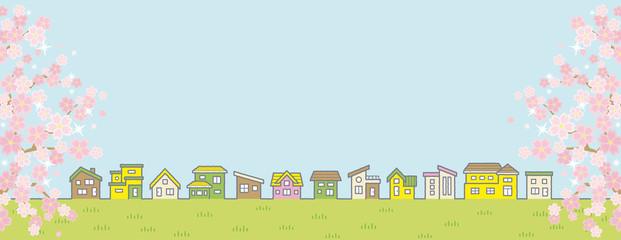桜のある春の田舎の風景のイラスト(家の並びと空と草原)横に長い書式用シンメトリータイプ