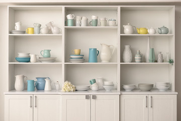 Fototapeta Cupboard with clean dishes in kitchen obraz