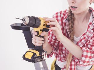Hand holding yellow drill