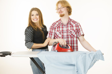 Man and woman couple ironing clothes