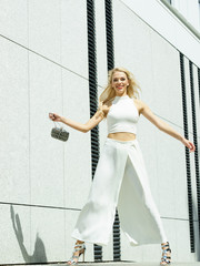 Playful woman wearing crop top and culottes