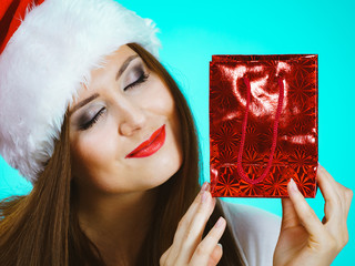 Happy Christmas woman receiving gifts