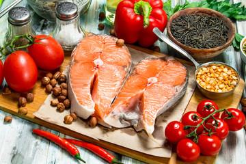 Healthy food. Salmon steaks with organic food.