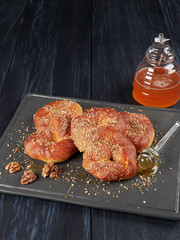 Romanian mucenici from Moldova region: figure eight shaped sweet bread, sprinkled with honey and crushed nuts. Traditional dessert for the Christian feast of the 40 Martyrs of Sebaste