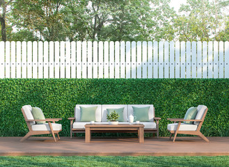 Living in the garden 3d render,  There is a wooden floor terrace,white fence,furnished with wood and white fabric furniture.