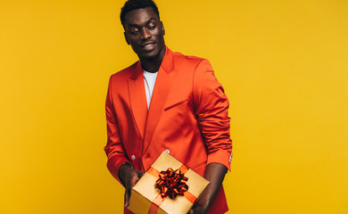 Stylish african man with a gift
