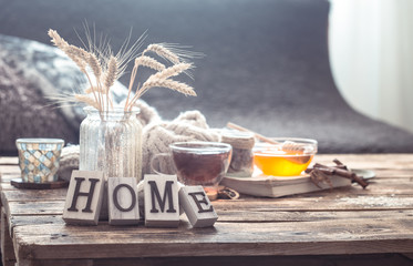 Still life details of home interior on a wooden table