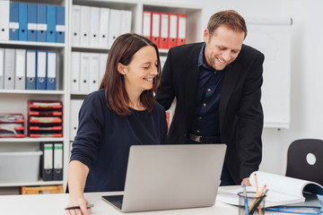 Successful happy business team reading a report