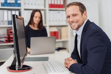 Stylish businessman with a happy friendly smile