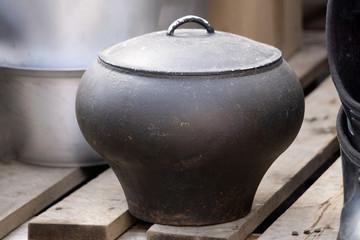 Vintage iron pot isolated on white background .