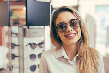 woman wearing sunglasses in optic store