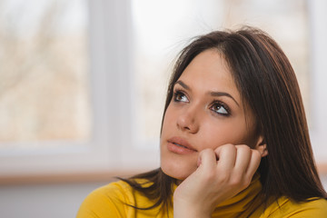 portrait of thoughtful young woman