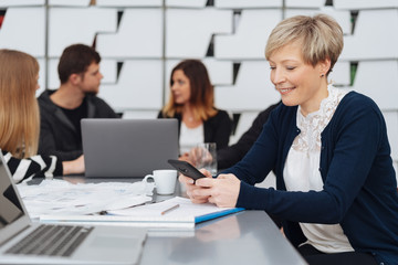 Happy attractive businesswoman in a meeting