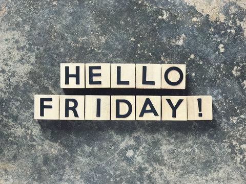 Motivational and inspirational quote - HELLO FRIDAY written on wooden blocks.