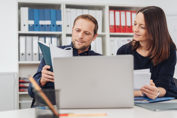 Businessman and woman working on paperwork