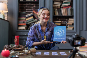 Nice cheerful woman pointing at the book