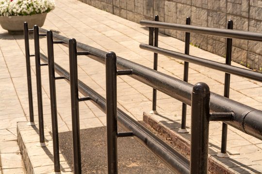 Metal handrails at the ramp for the disabled