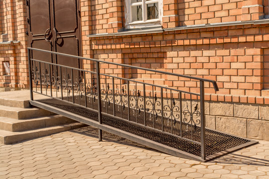 Metal ramp for disabled people, summer day