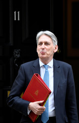 Britain's Chancellor of the Exchequer Hammond walks outside Downing Street in London