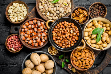 Assortment of different nuts in bowls.