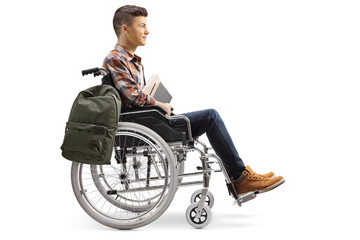 Male student in a wheelchair holding books