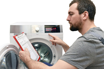 repair washing machine by a service technician at customer's home // insulated on white background