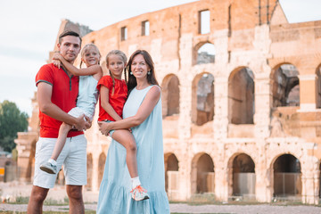Fototapeta Happy family in Rome over Coliseum background.