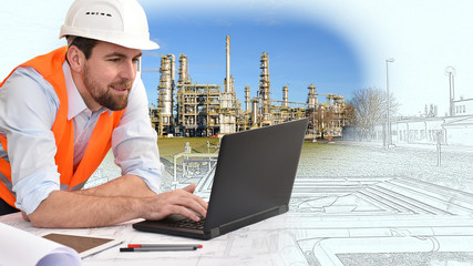 engineer at his workplace with notebook in an industrial company in mechanical engineering