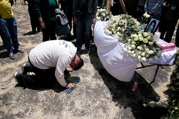A Chinese man mourns a victim of the Ethiopian Airlines Flight ET 302 plane crash during a commemoration ceremony at the scene of the crash, near the town of Bishoftu, southeast of Addis Ababa