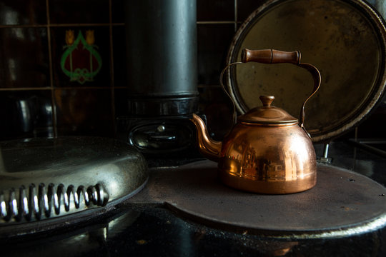 copper kettle on a wood burning stove