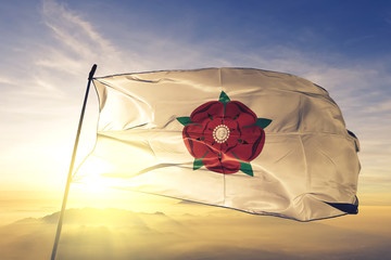 Lancashire county of England flag waving on the top sunrise mist fog Wall mural