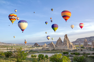 Hot air balloons in the sky over the cave town, Valley of Daggers, Cappadocia, Turkey Wall mural