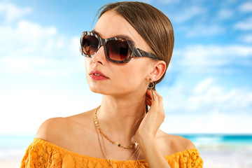 Slim young woman and sunglasses. Summer time