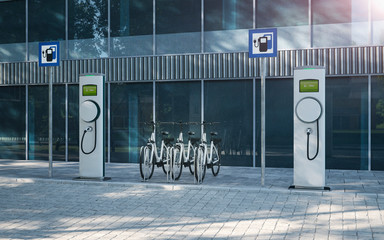 Electric bicycle e-bike at company parking lot with electric charging station 3d illustration