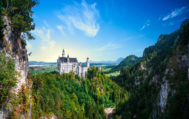 Pamoramic view of world-famous Neuschwanstein Castle in Germany Alpine mount