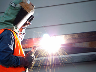 Welding work ,worker with protective welding metal on construction