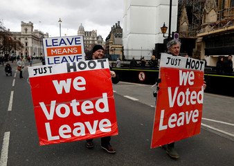 Pro-Brexit protesters demonstrate outside the Houses of Parliament in London