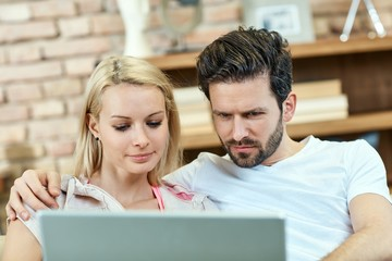 Closeup photo of couple using laptop