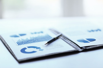 Obraz background image of a clipboard with financial report on table - fototapety do salonu