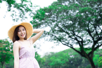 Young Asian woman is smile and feeling relax with nature background.