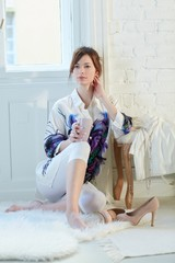 Attractive woman sitting on floor at home