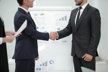 close up.handshake of business partners before business presentation