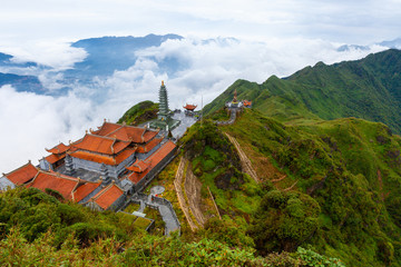 View of mountains and the temple from the Fansipan peak, Sapa, Vietnam