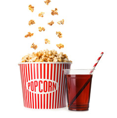 Bucket with delicious popcorn and plastic cup of cola on white background