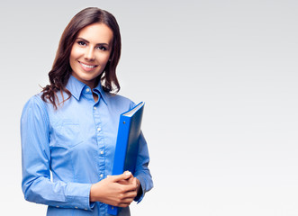 Businesswoman with blue folder, against grey