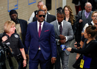 Grammy-winning R&B star R. Kelly leaves the Cook County courthouse after a hearing in his child support case in Chicago